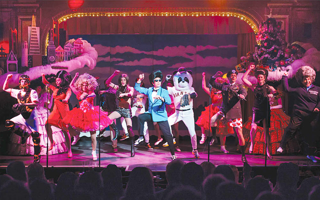 Image of one of Beach Blanket Babylon's cast ensembles on stage