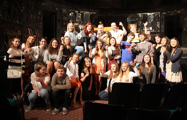 image of a group of FastForward reporters on set with the cast of ONCE