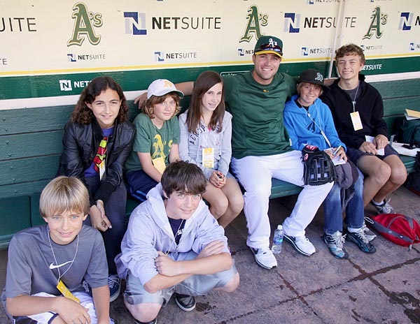 Image of the A's pitcher Joey Devine with the Adventure Reporters