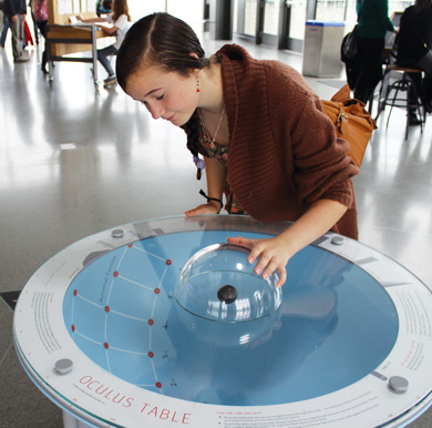 Image: A curious reporter checks out the Exploratorium's Oculus Table exhibit