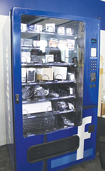 Image of a vending machine at Facebook headquarters that dispenses worker needs such as computer keyboards, etc.