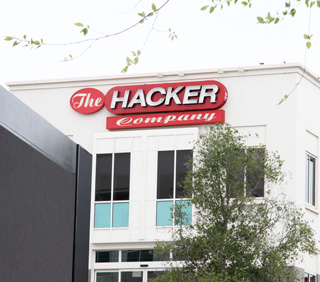 Image of sign on a Facebook building with letters The Hacking Company
