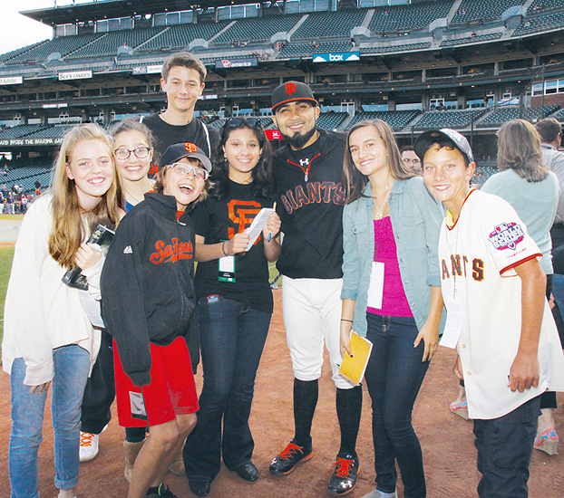 Image of a group of our FastForwad reporters posing Giants closing pitcher Sergio Romo