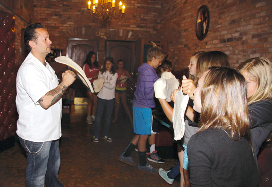 Image of Tony Gemignani showing the FastForward reporters how to toss and make pizza