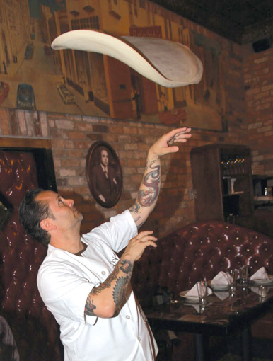 Image of Tony Gemignani demonstrating his pizza toss skills